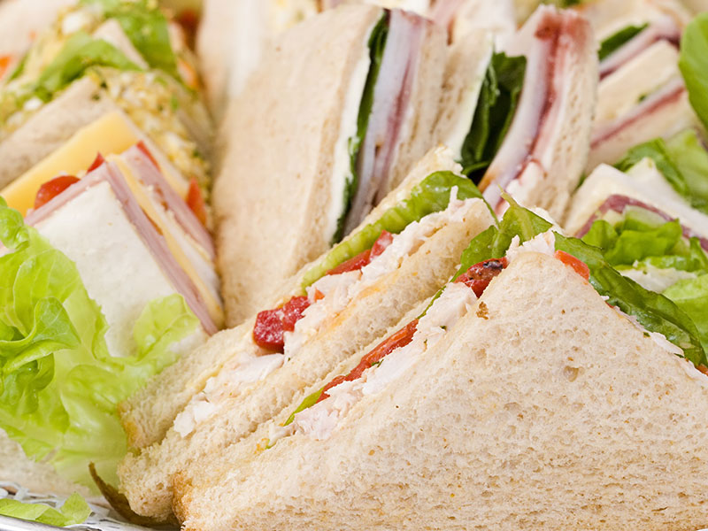 Fresh catered sandwiches with cheese and ham