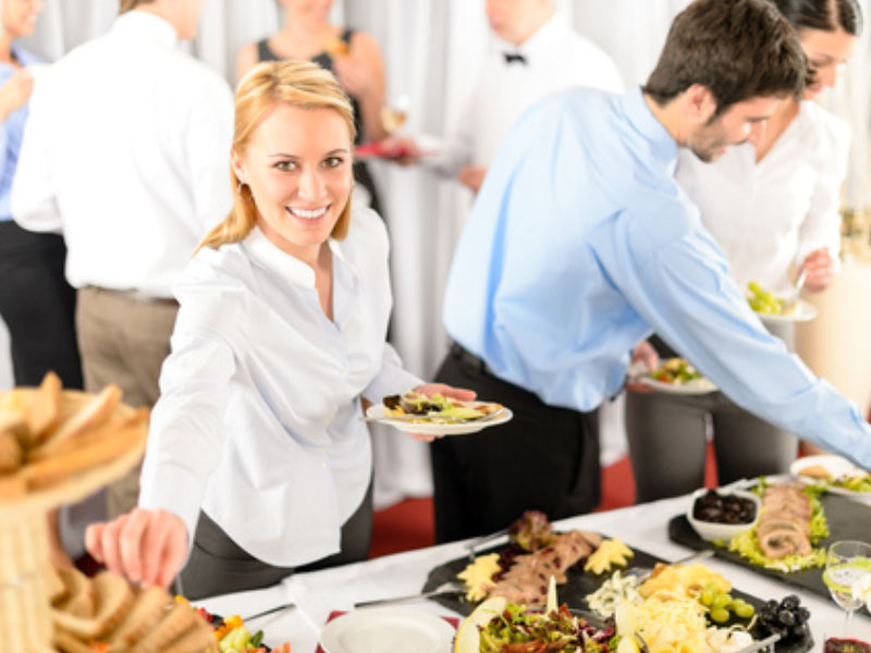 Happy employees enjoying office catering