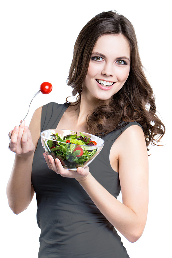 Happy employee eating fresh salad with tomatoes